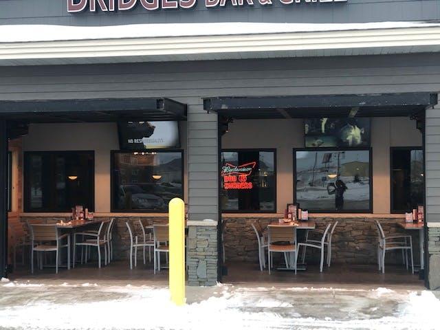 a close up of Bridges Bar & Grill store front