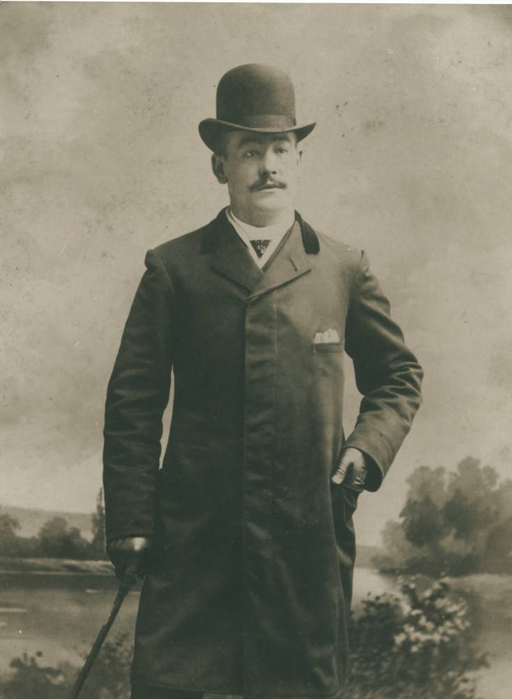 a vintage photo of a man wearing a suit and tie