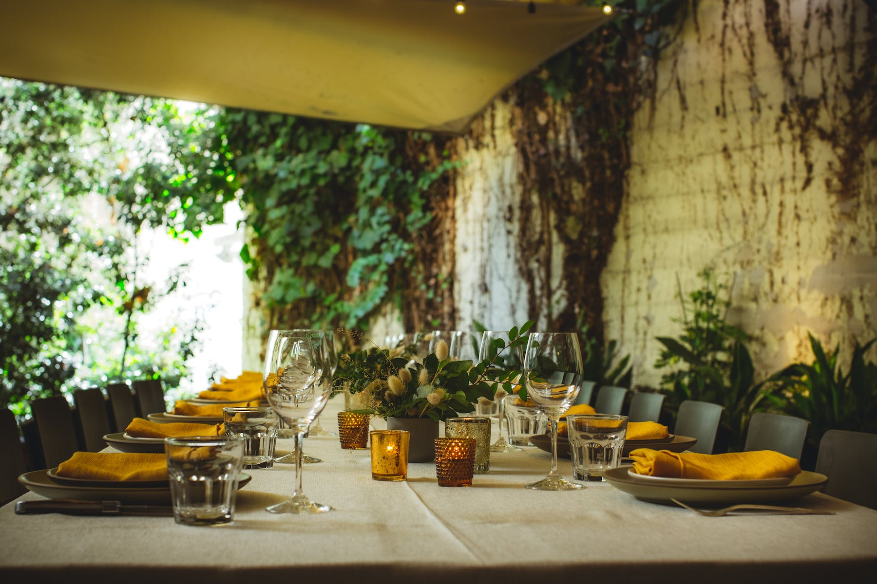 a large table decorated with yellow napkins over the plates