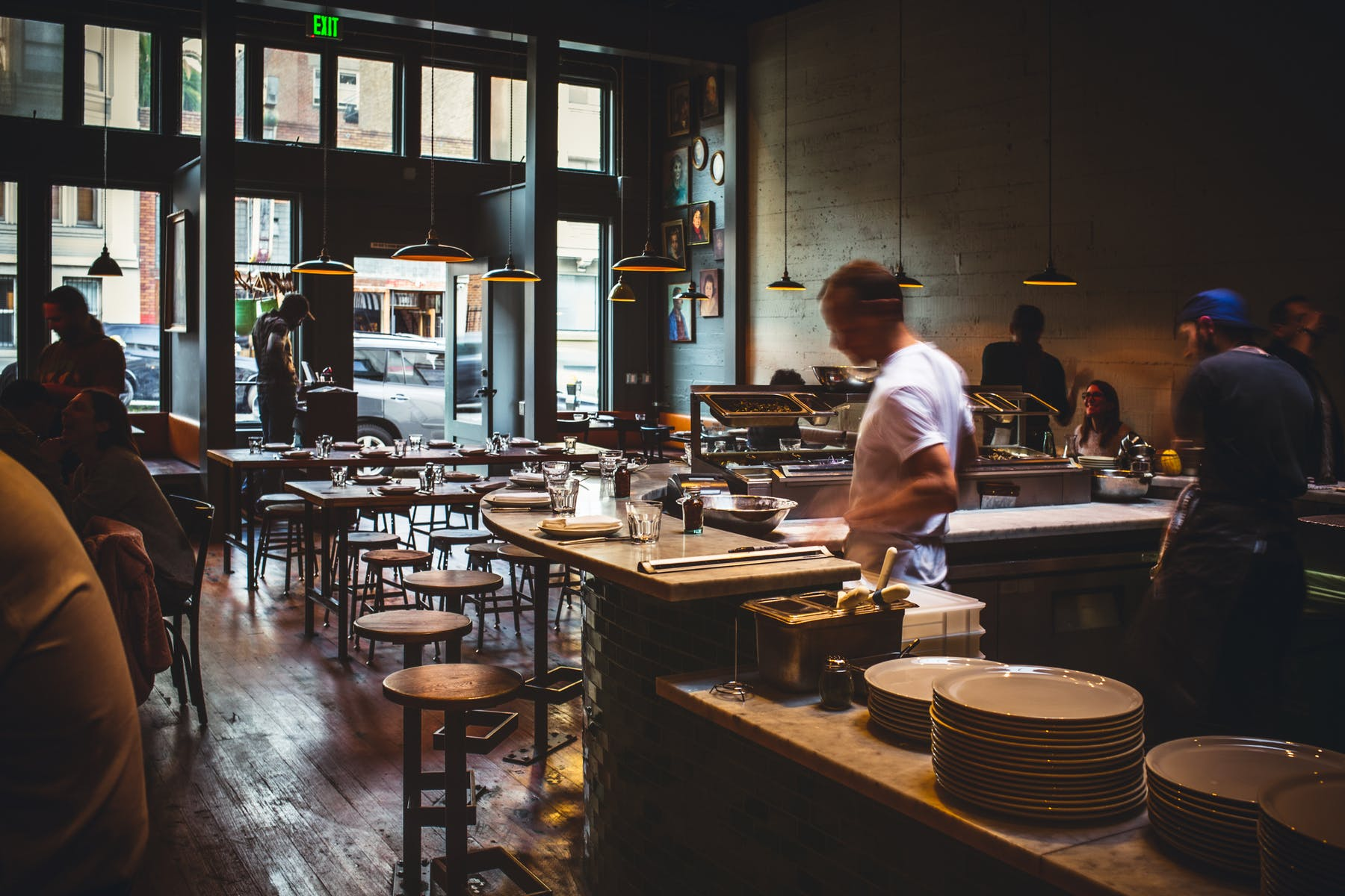 a man in the cooking area of the restaurant