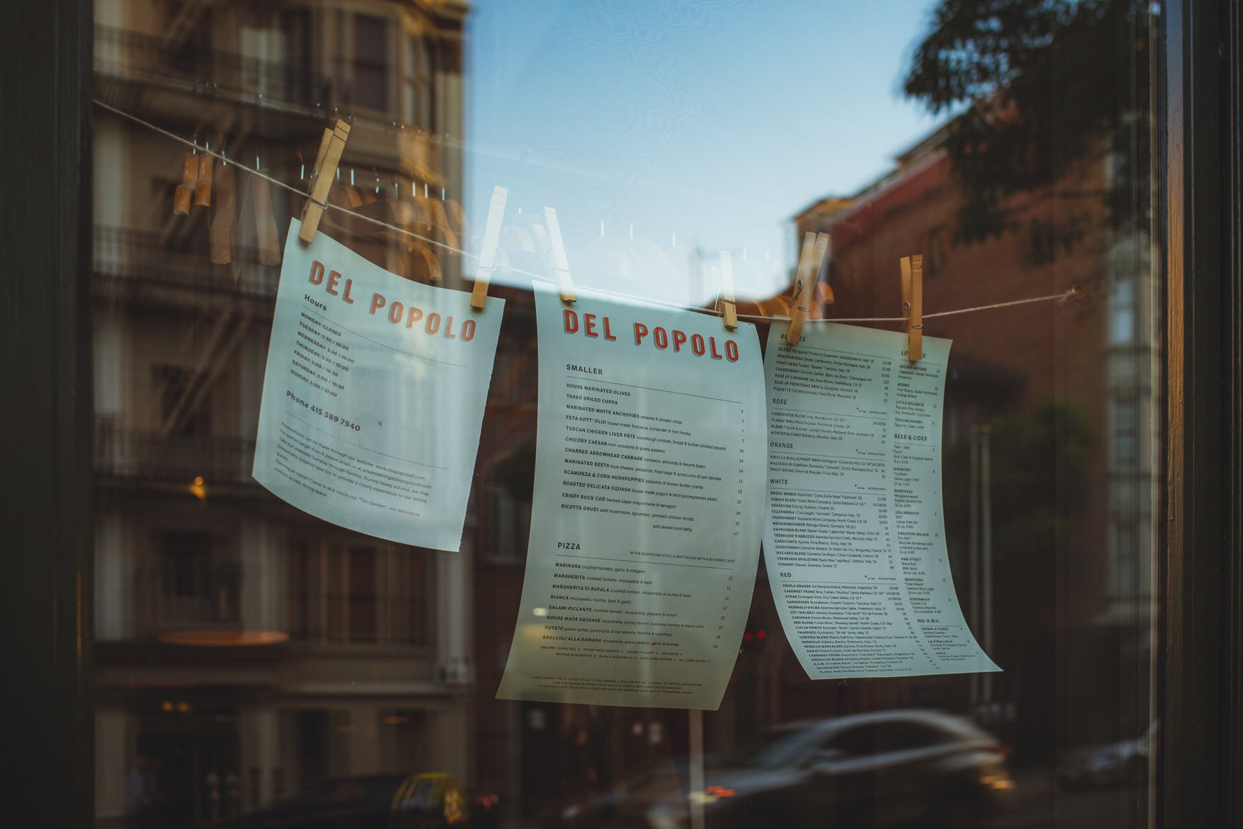 a string with the menus hanging on the restaurant window