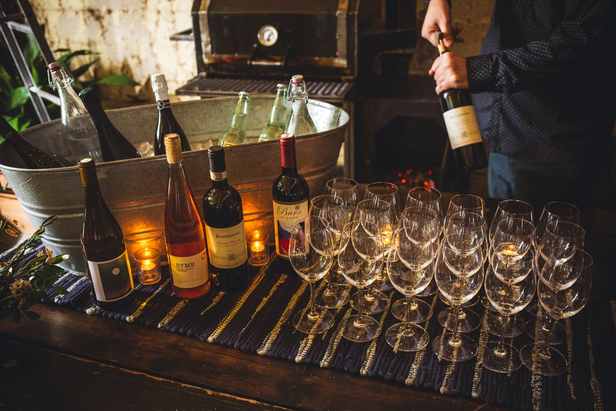 bottles of wine and glasses on a table