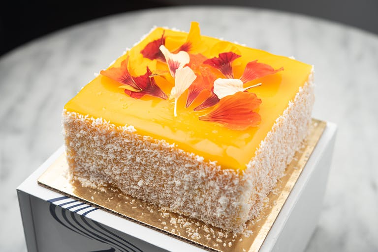 A slice of coconut and mango cake.