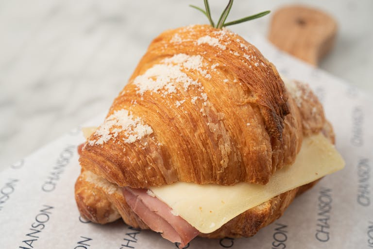 A ham and cheese croissant.
