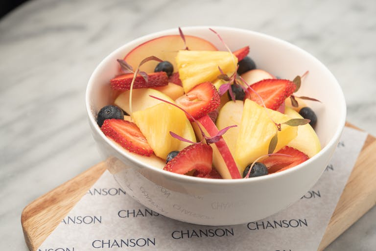 A bowl of fruit salad.
