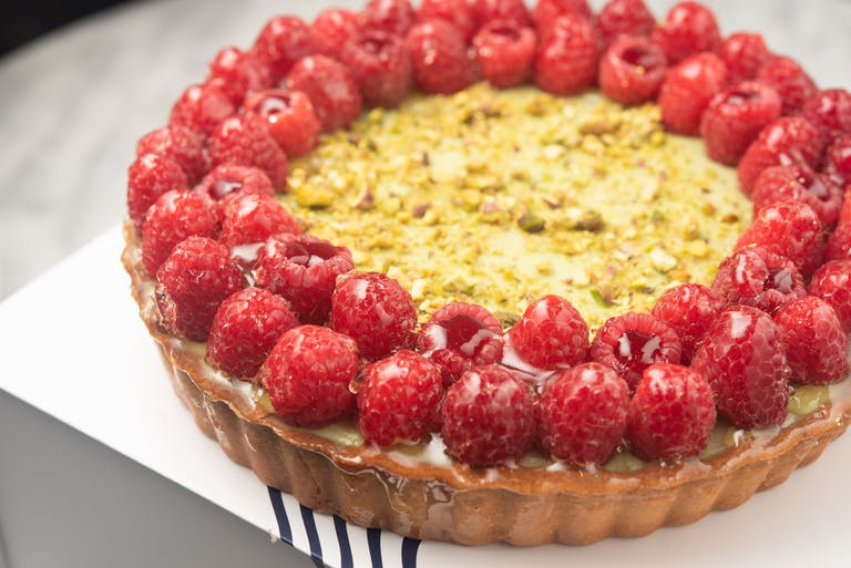 A tart with seasonal fruit on top.