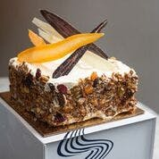 A slice of CARROT & COCONUT CAKE.