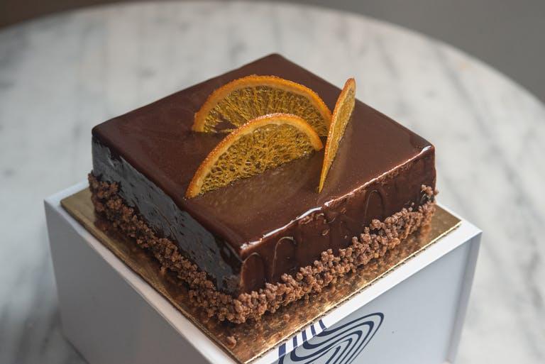 A slice of BLOOD ORANGE & EARL GREY CHOCOLATE MOUSSE cake.