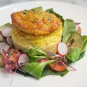 A quiche with small salad.