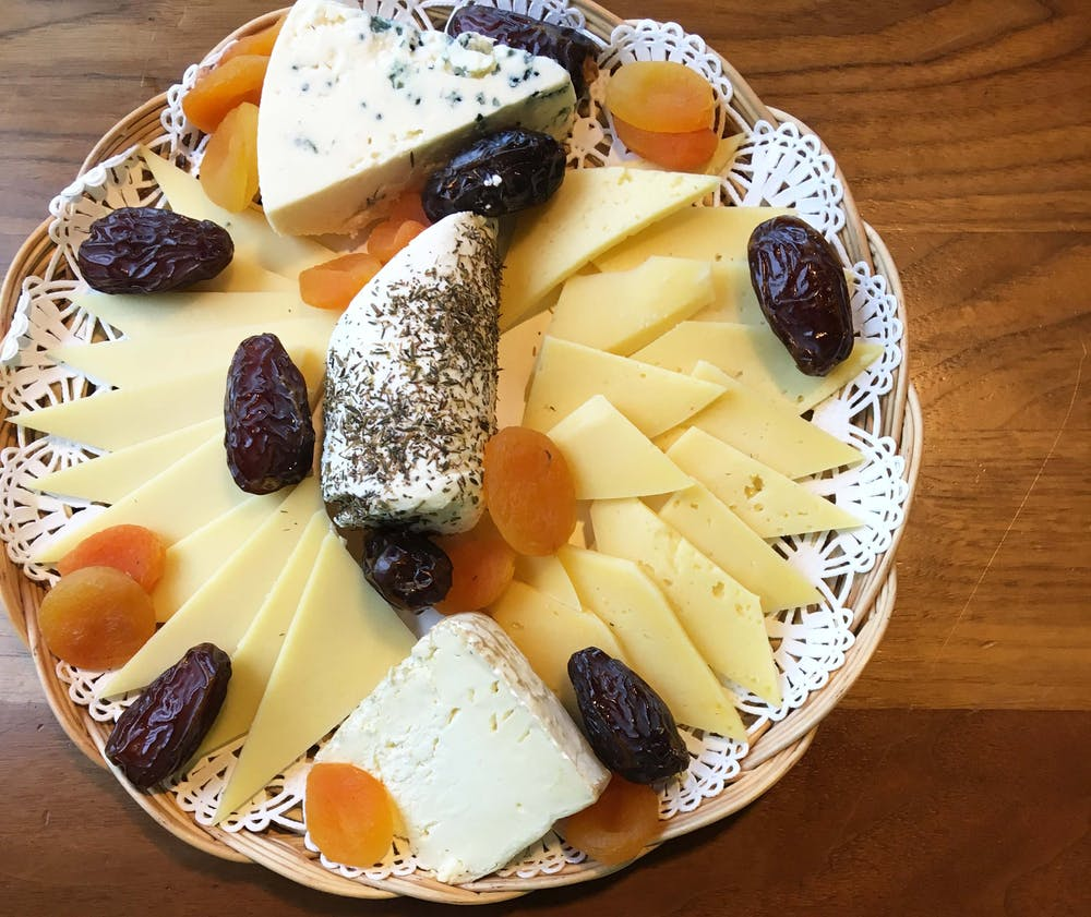 a plate of cheese presented on a platter.