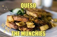 a sandwich on a plate text Queso the Munchies
