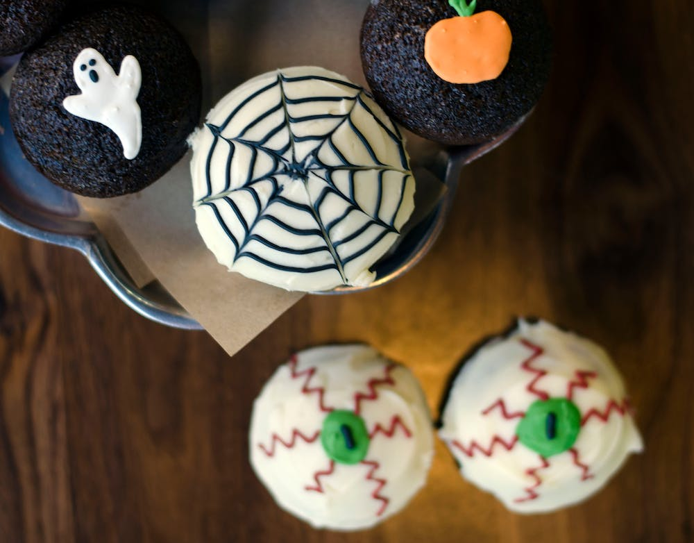 a close up of Halloween cupcakes