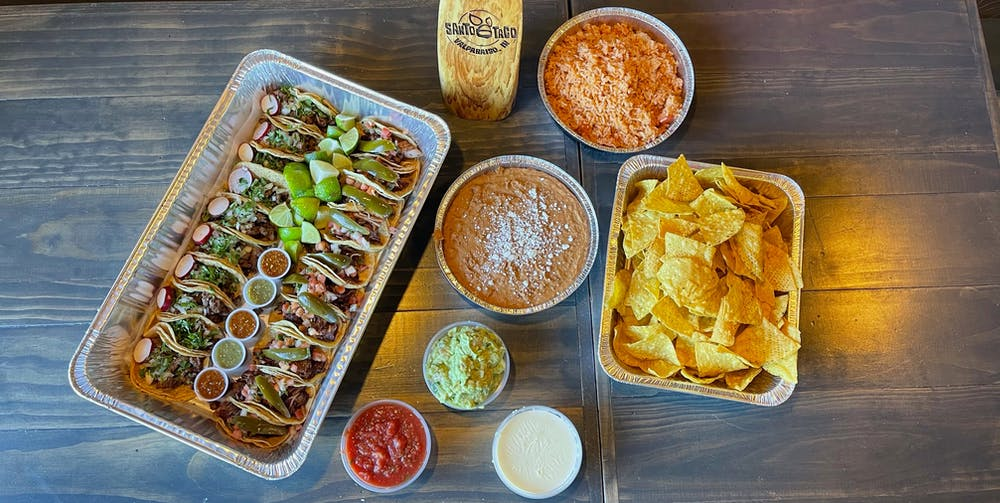 a tray of food on a wooden table