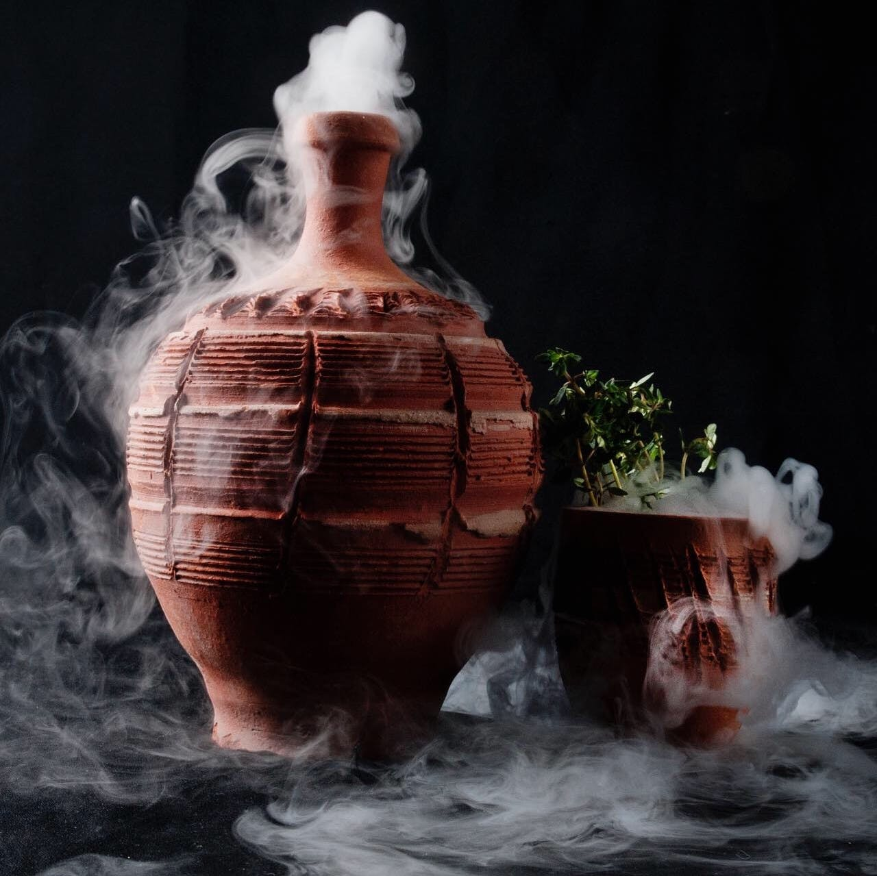 a close up of a bottle steaming vapor