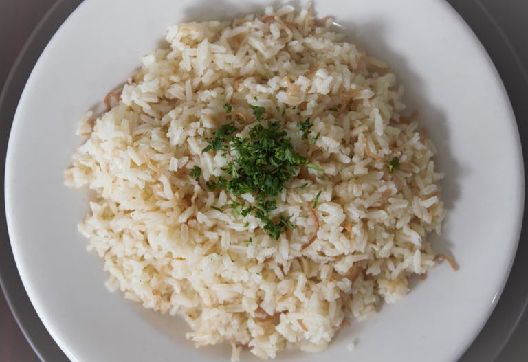 a plate of food with rice and broccoli
