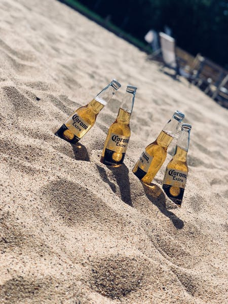 corona beers set on the sand