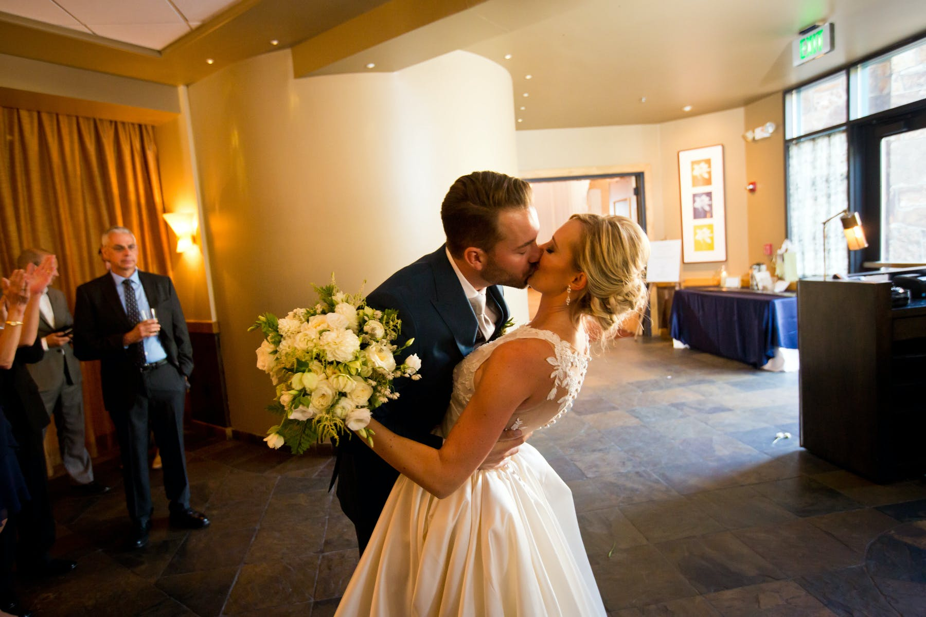 Larkspur Wedding Venue Vail Colorado Mountain Patio Bar Bride and Groom Kiss