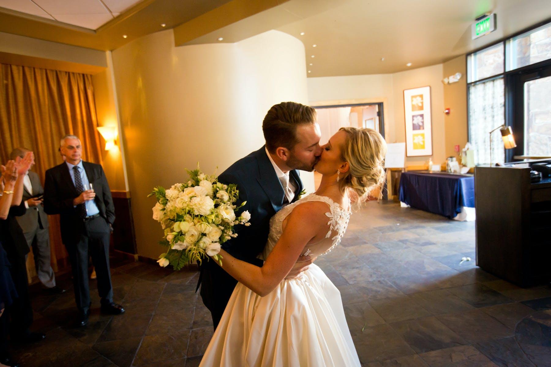 Larkspur Wedding Venue Vail Colorado Mountain Patio Bar Bride and Groom Kiss