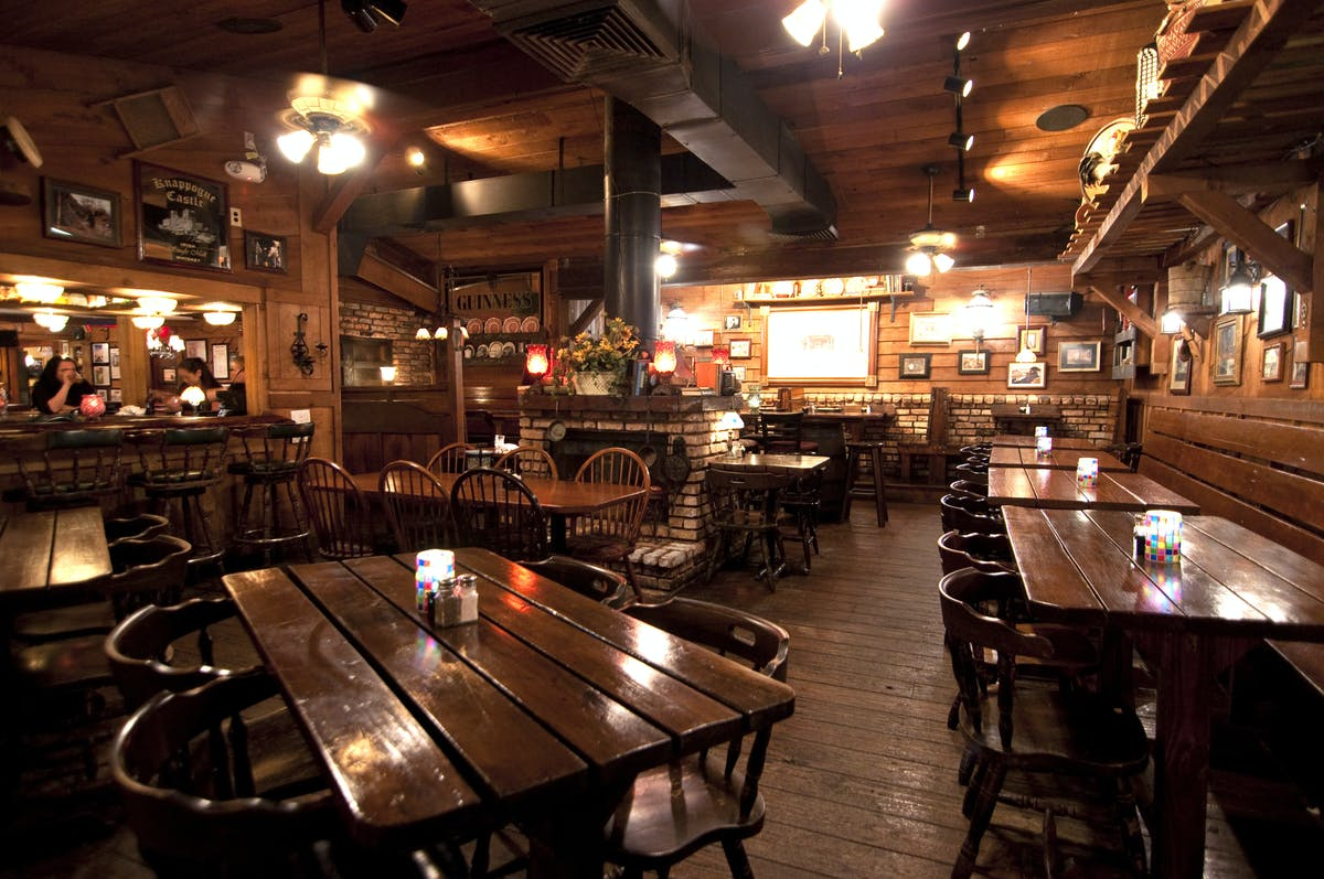 a large dining room filled with wooden furniture