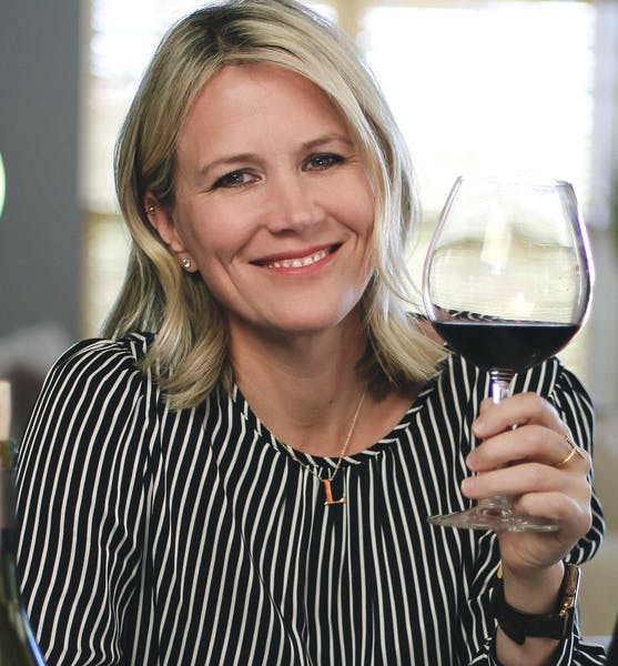 Leslee Miller holding a wine glass