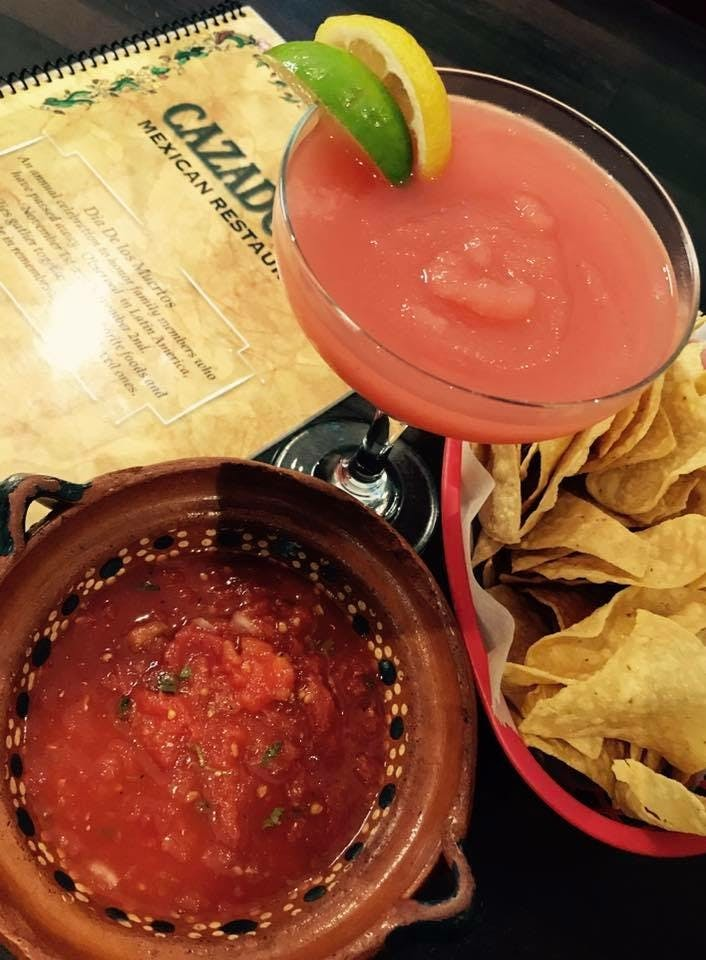 a margarita with chips and salsa on the side
