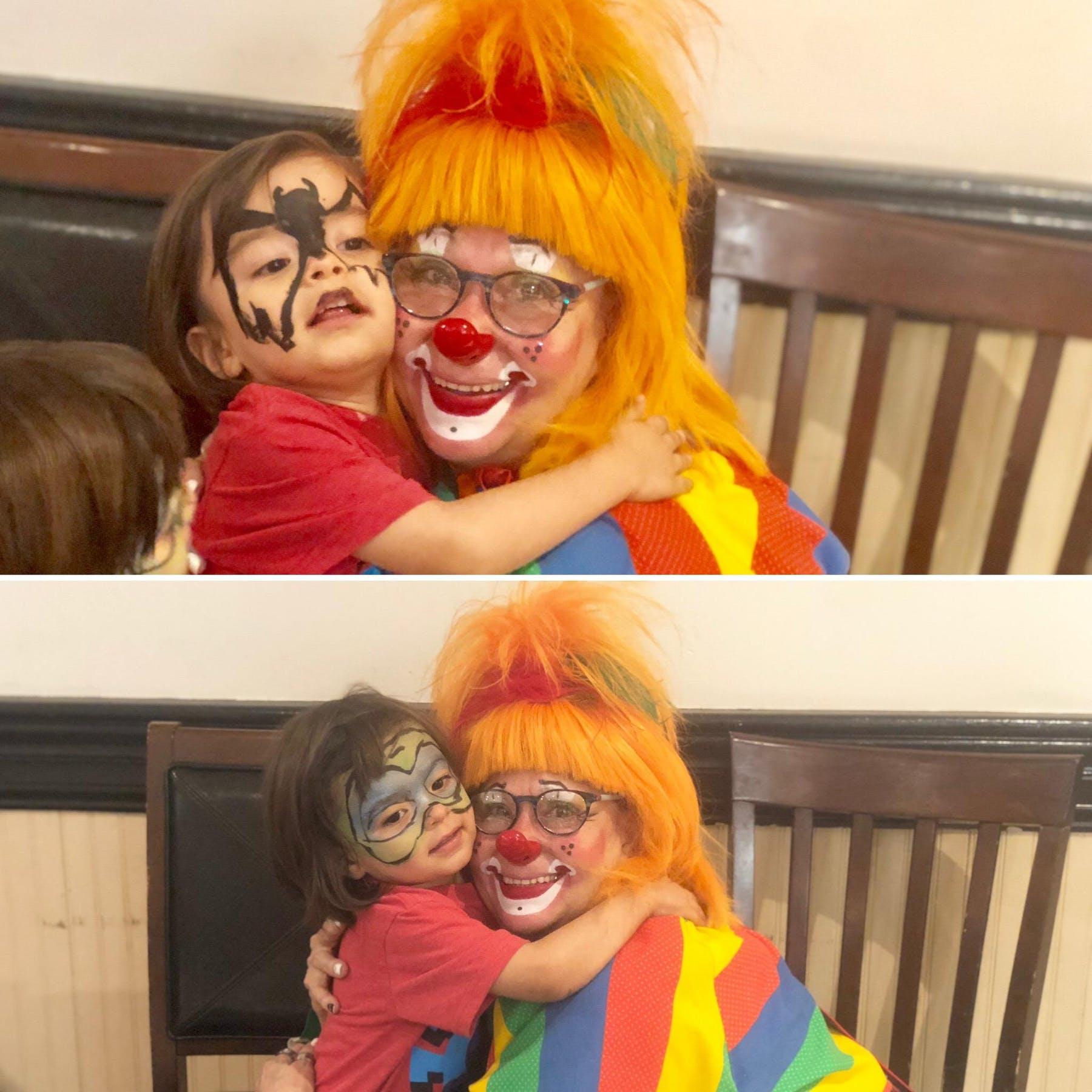 a child hugging clown