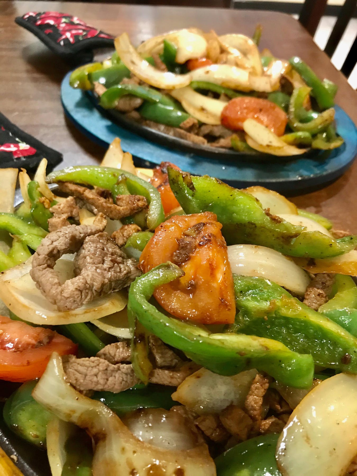 a plate of fajitas and greens