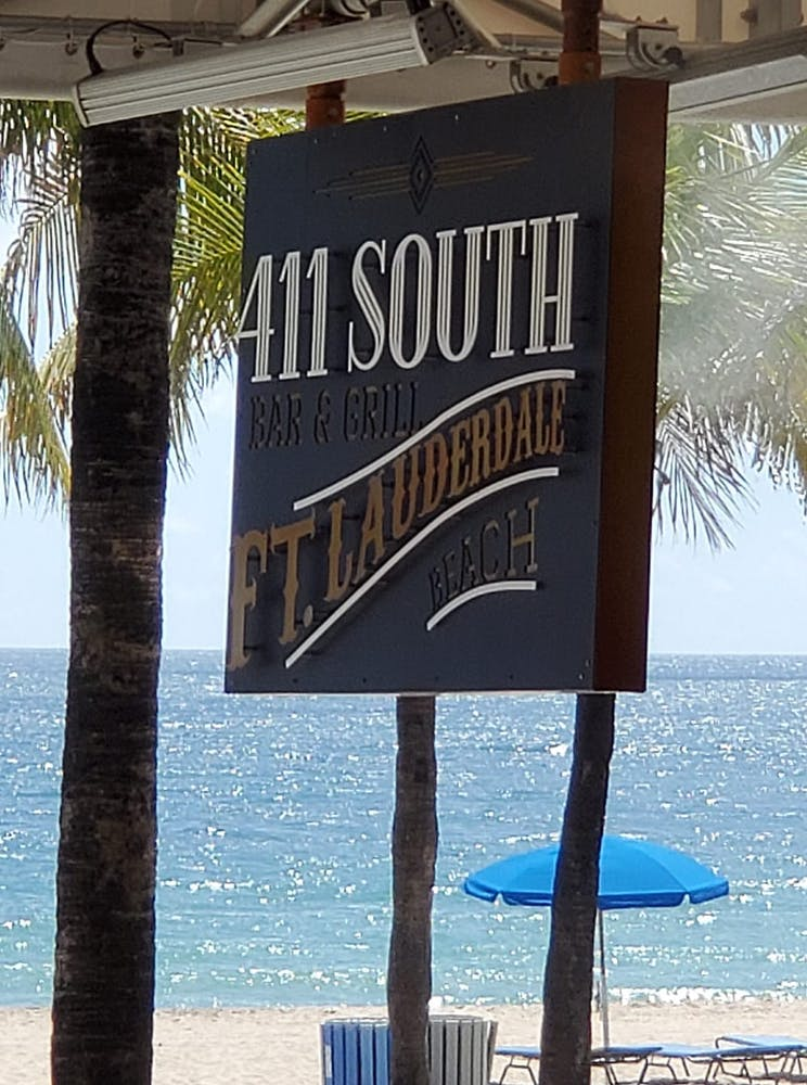 a sign on a beach