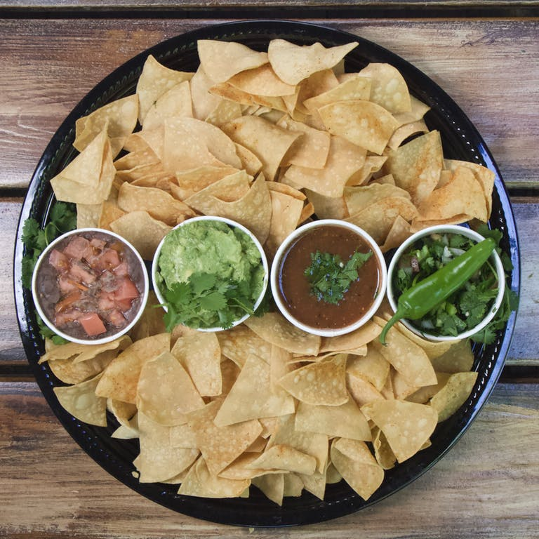 a bowl of food on a wooden table