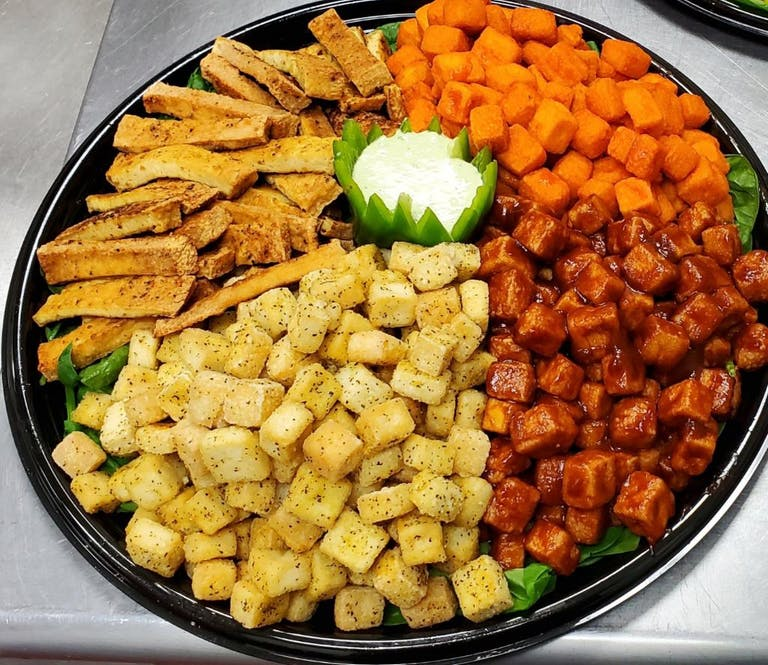 a dish is filled with different types of food on a plate