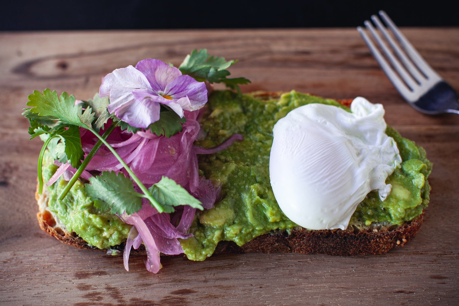 toast with avocado spread and  poached egg