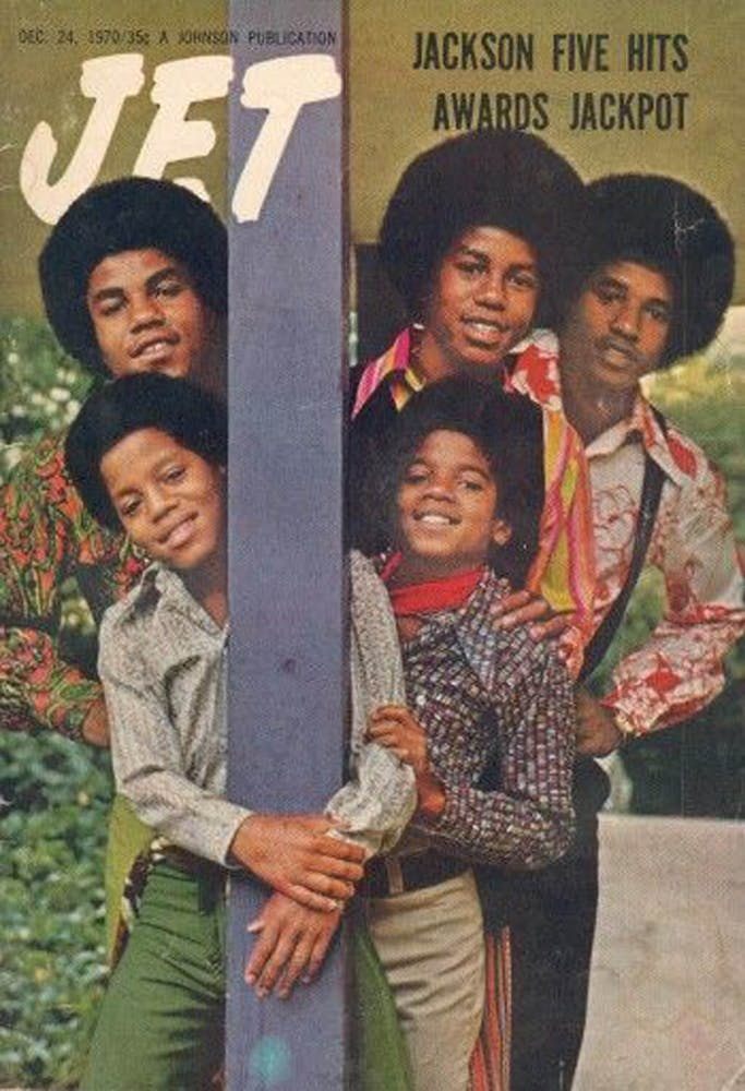 Marlon Jackson et al. posing for the camera