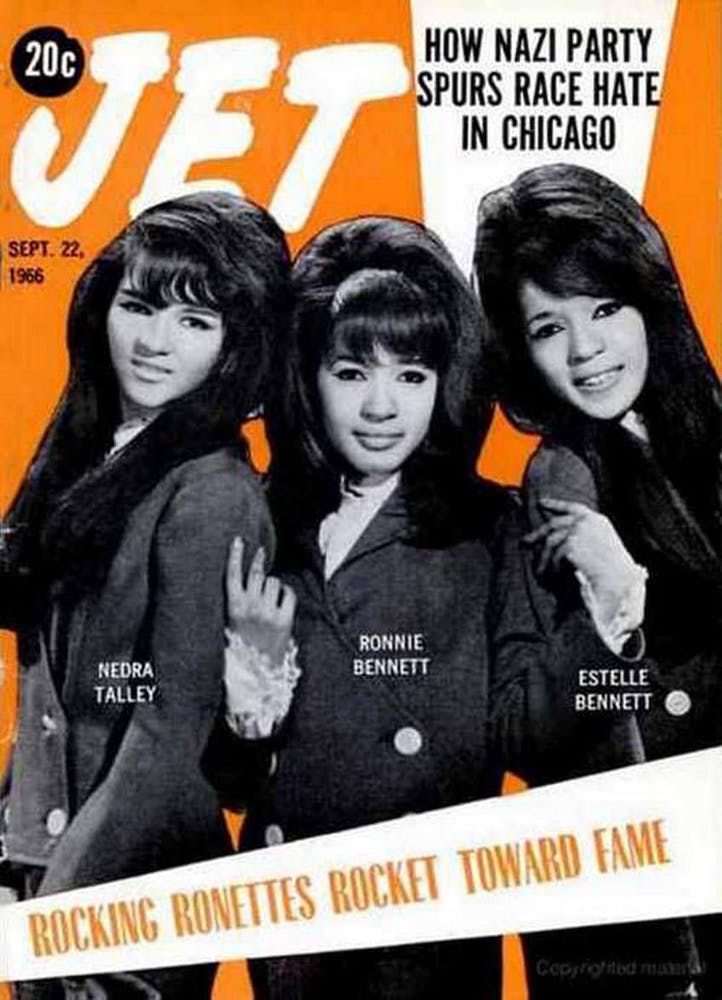 Nedra Talley, Ronnie Spector, Estelle Bennett looking at a book