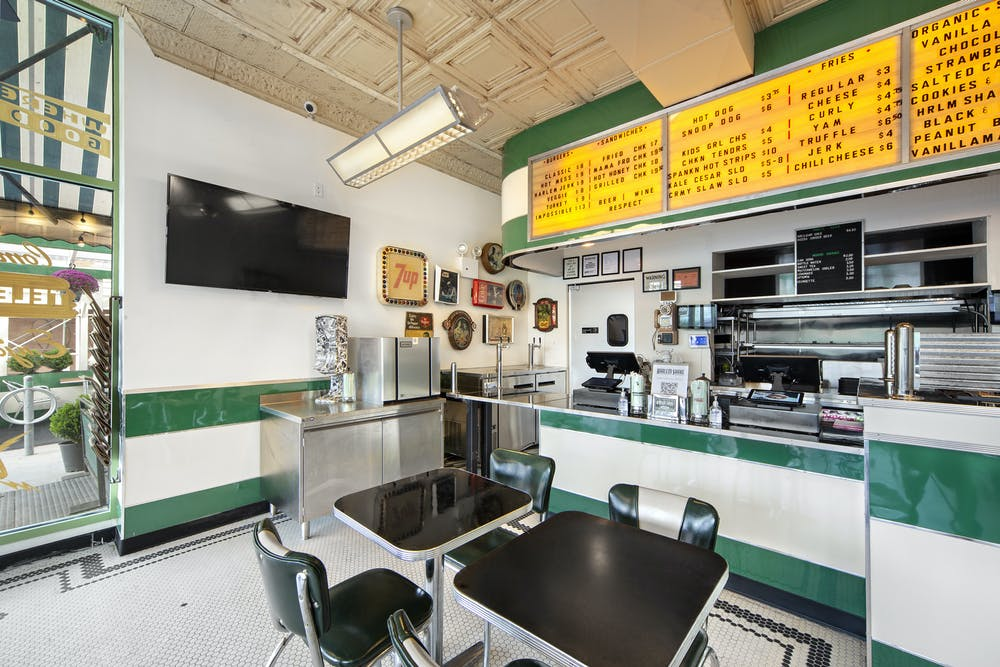 a kitchen with green walls