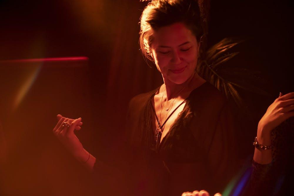 Jude Vargas standing in a dark room