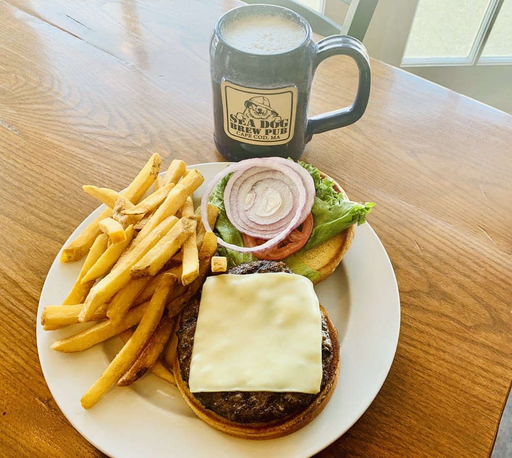 a plate with a sandwich and fries on a table
