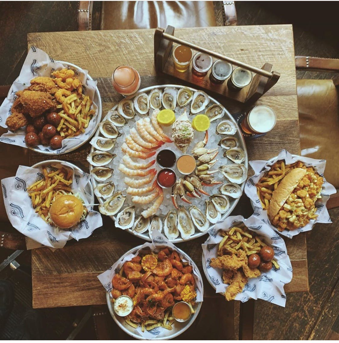 a wooden table topped with different types of food on a plate