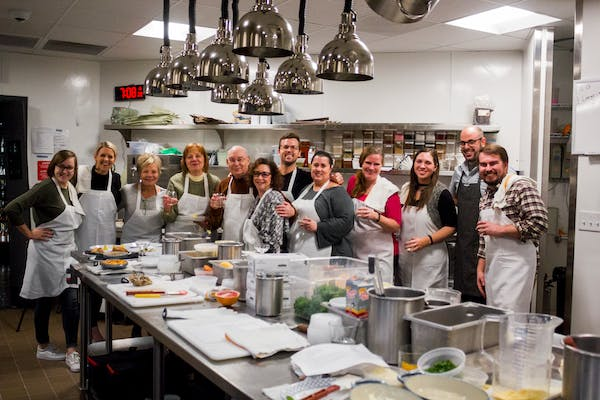 Kitchen of Wrigleyville neighborhood restaurant with cooking class participants