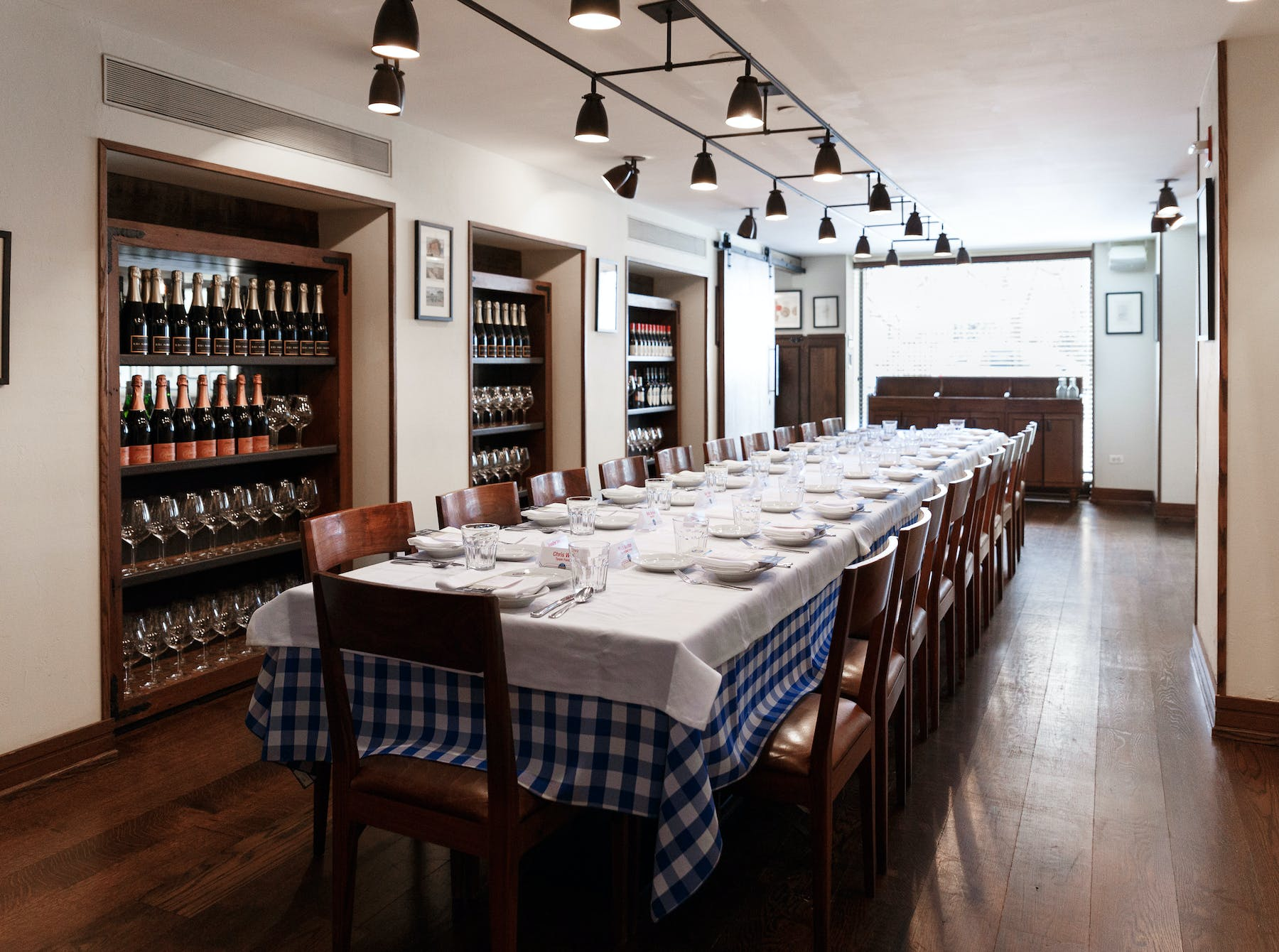 a view of the empty Maialino private dining room, overlooking Gramercy Park, with a single table that seats 24
