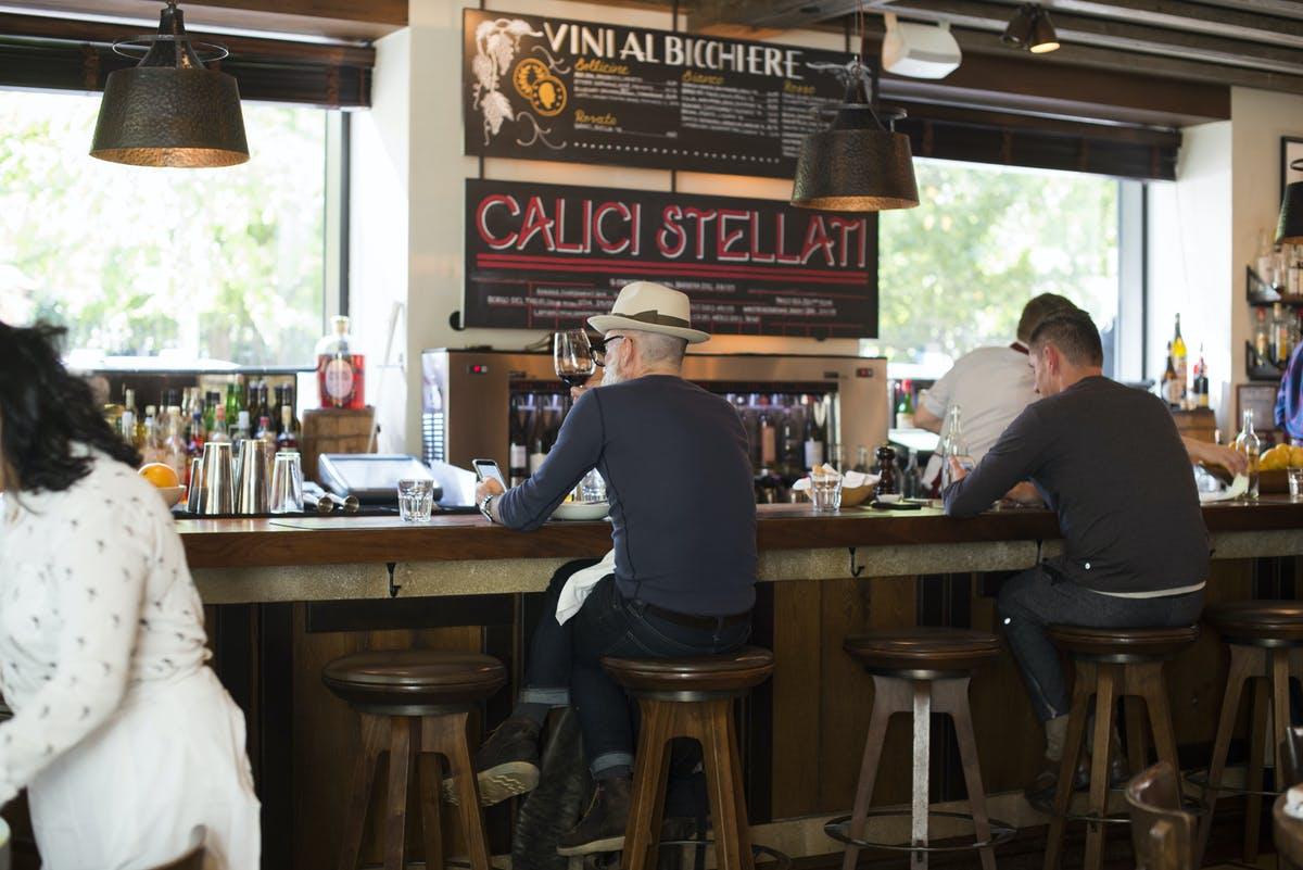 a guest sitting at the bar at Maialino