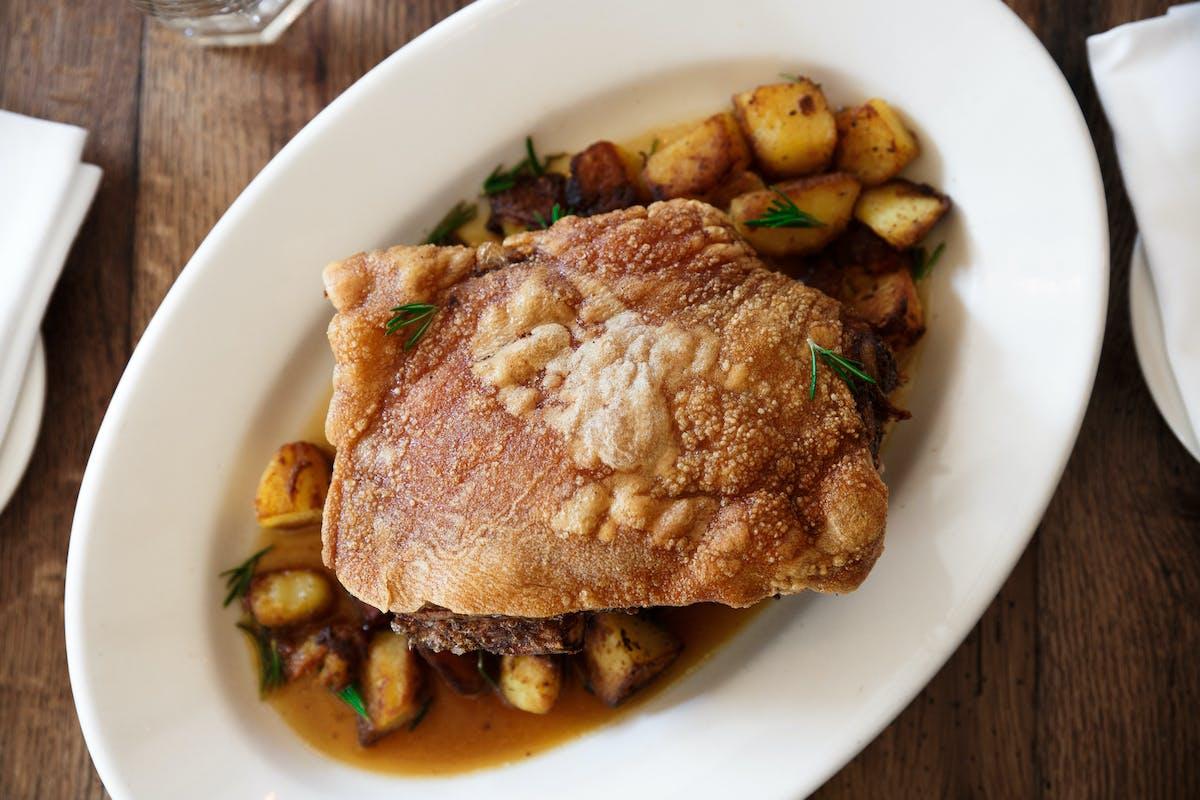 maialino al forno - our signature dish of roast pork and potatoes