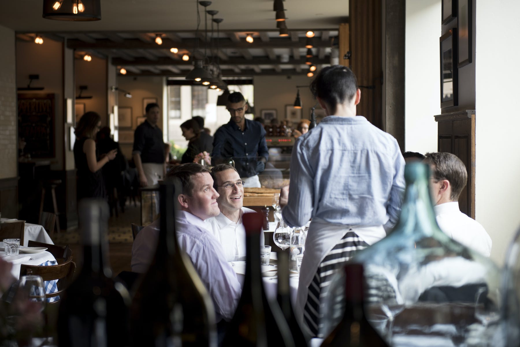 A server at Maialino interacting with guests