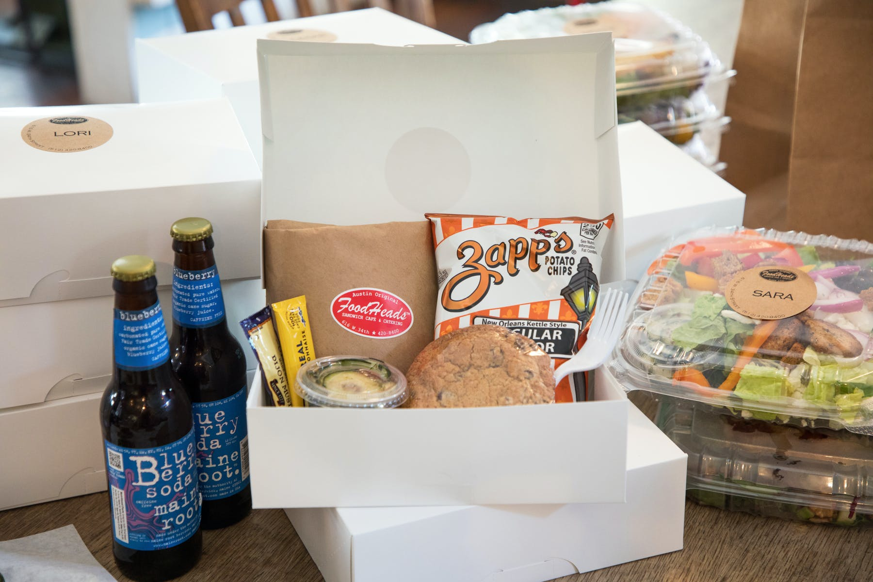 a box filled with different types of food on a table