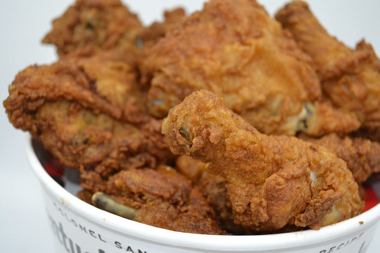 a closeup of a basket full of fried chicken