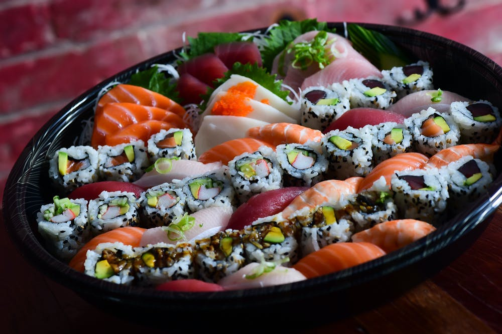 a bowl full of different seafood rolls