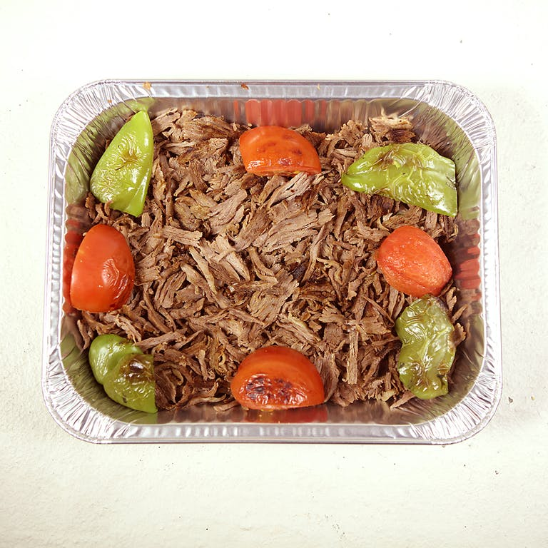 a plastic container filled with meat and vegetables