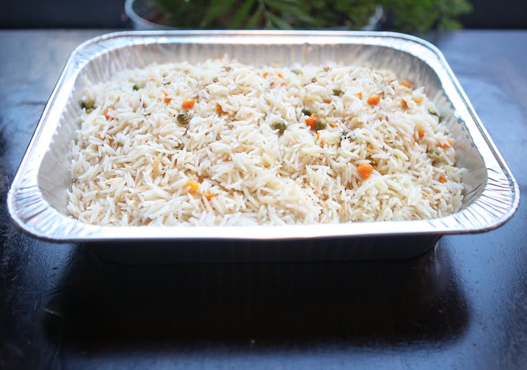 a tray of food with rice