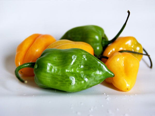 a bowl of fruit - aji verde peppers