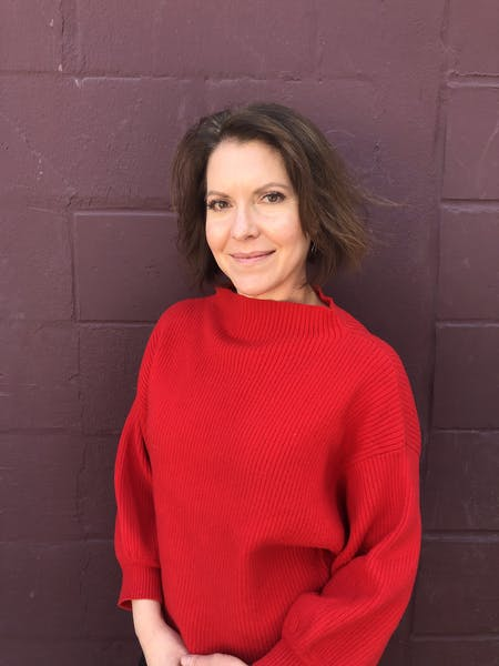 a person wearing a red sweater