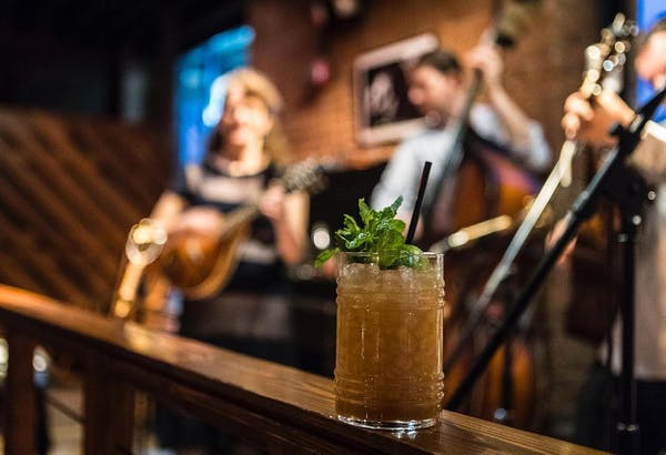 a cocktail and a live band at Porchlight